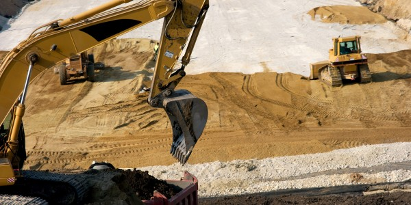 Excavator working at a road construction site